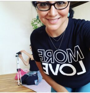 "Health Coach Jocelyn Martinez wearing a teeshirt that says ""Love More"""
